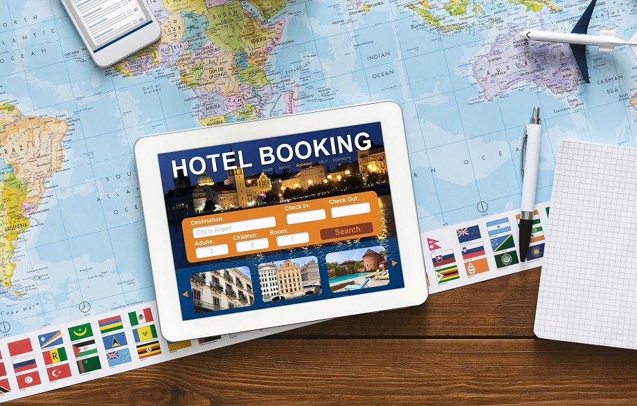 Tablet With Hotel Booking Application Lying On Desk, Collage, Above-View